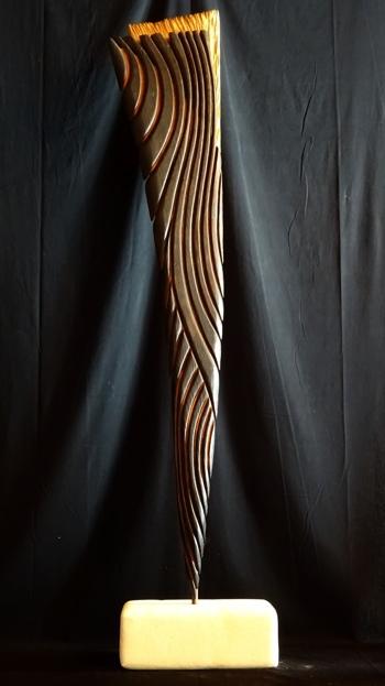 """Crop circle fragment / Matières : Chêne, bois brûlé, pigment naturel d'ocre rouge, cire, pierre de Castrie. / Dimensions: 148cm x 33cm / Prix : 750€ / """"Témoin d'une irréalité, au coeur des moissons. L'esthétisme en point d'orgue d'une grande interrogation."""""""